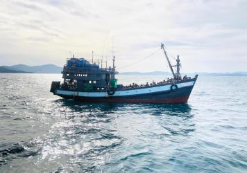 A handout photo released on April 5 by Malaysia shows a trawler carrying Rohingya migrants off the island of Langkawi. It was not immediately clear if it was the same vessel as rescued late Wednesday off Bangladesh's coast.