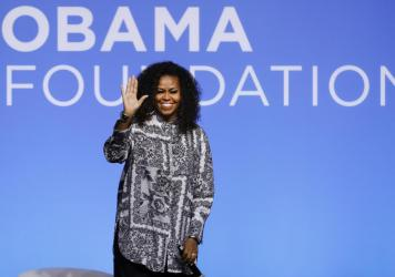 Former U.S. first lady Michelle Obama waves as she attends an event for Obama Foundation in Kuala Lumpur, Malaysia, in December 2019. Obama and actress Julia Roberts attended the inaugural Gathering of Rising Leaders in the Asia Pacific organized by the