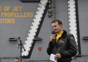 Navy Capt. Brett Crozier is pictured in November 2019 on the USS Roosevelt. Navy officials have not ruled out reinstating him. He was fired as commander of the aircraft carrier after complaining wasn't getting enough help containing the coronavirus on bo