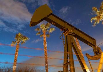 Pump jacks draw crude oil near Long Beach, Calif., on March 9. A U.S. crude oil benchmark has hit record lows.
