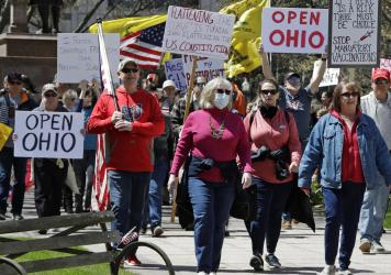 People gather outside the Ohio Statehouse in Columbus on Monday to protest the state's stay-at-home order, which is in effect until May 1.