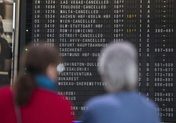 A destination board shows canceled flights at Frankfurt Airport in Germany last month. The coronavirus pandemic has disrupted travel plans for refugees who'd been granted asylum in various countries.