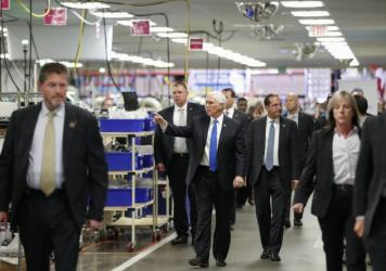 Vice President Pence tours a GE ventilator plant in Madison, Wis., last week — one of a series of trips the White House is learning from before President Trump resumes travel.