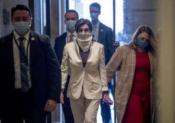 House Speaker Nancy Pelosi arrives on Capitol Hill wearing a mask.