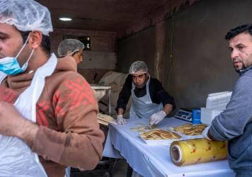 A pop-up bakery in the town of Shoubak, Jordan, offers traditional Ramadan dessert known as <em>qatayef</em> a day before the start of the holy month.