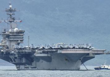 "The acting secretary of the Navy is seeking a more thorough review of ""decisions of the chain of command surrounding the COVID-19 outbreak aboard the USS Theodore Roosevelt."" The aircraft carrier is seen here as it enters the port in Da Nang, Vietnam, la"