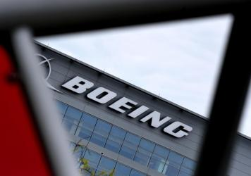 The Boeing headquarters is seen amid the coronavirus pandemic on April 29, in Arlington, Va. Boeing announced sweeping cost-cutting measures Wednesday after reporting a first-quarter loss of $641 million following the hit to the airline business from the