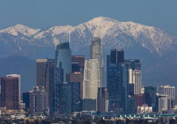 The San Gabriel Mountains are seen under a clear sky beyond downtown Los Angeles. Air quality in the U.S. and elsewhere has been improved by reduced traffic from coronavirus restrictions and weeks of rainstorms.