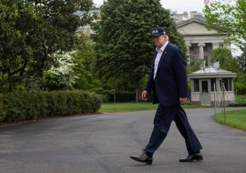 President Trump walks to the White House on Sunday, after returning from Camp David in Maryland.