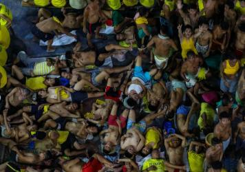 Prison inmates gather in cramped conditions in Manila's Quezon City Jail. Guards and inmates at the notoriously overcrowded Philippine jail tested positive for the COVID-19 coronavirus, officials said last month, sparking urgent calls for the release of
