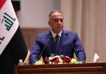 Mustafa al-Kadhimi speaks to Parliament in Baghdad on Thursday. Iraq's former spy chief was sworn in early Thursday as prime minister after weeks of tense political negotiations as the country faces a severe economic crisis spurred by the coronavirus pan