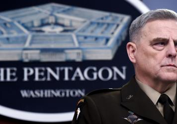 """Gen. Mark Milley, chairman of the Joint Chiefs of Staff, attends a media briefing earlier this year at the Pentagon. He told NPR on Thursday that the U.S. military is still considering """"a whole series of protocols"""" when it comes to the coronavirus."""