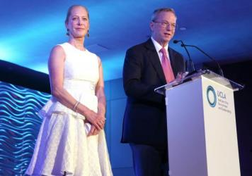 Wendy and Eric Schmidt, shown here at a 2016 event for UCLA, have given $4.7 million to NPR to boost investigative reporting and news coverage in the Midwest and California.