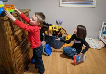 Camdyn and Caydance Austin play together at their home in Windsor, Illinois.