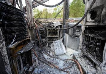 Cabling and telecommunications equipment is damaged after a fire in April in Huddersfield, England. The fire came as other cellphone towers burned amid conspiracy theories linking 5G mobile technologies to the coronavirus.