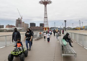 On Sunday, visitors strolled the pier at Coney Island beach. New York state parks  reopened for the Memorial Day weekend at 50% capacity, and campgrounds were given the green light to reopen Monday.