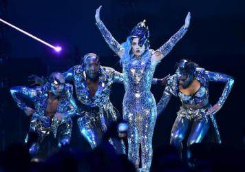 Lady Gaga performs in Miami in February. Following a turn to traditional pop and roots rock on recent projects, the singles from her forthcoming sixth album, <em>Chromatica</em>, have indicated a return to the maximalist dance pop that first made her fam