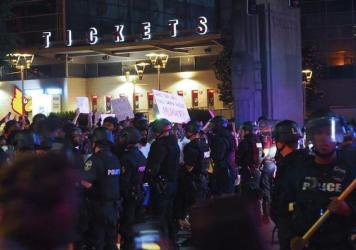 Police officers gathered Thursday in downtown Louisville, Ky., as protesters demonstrated against the killing of Breonna Taylor, a black woman fatally shot by police in her home in March.