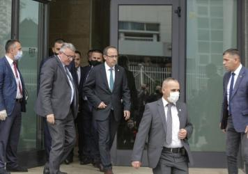 Newly elected prime minister Avdullah Hoti (center) walks out of the parliament building in the capital Pristina, on Wednesday.