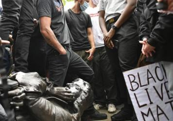 Protesters pull down a statue of slave trader Edward Colston during a Black Lives Matter protest on College Green, Bristol, England, on Sunday. The protest grew in response to the recent killing of George Floyd by police officers in Minneapolis that spar