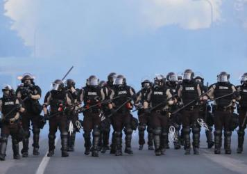 Minnesota State Patrol officers clear an area after curfew in Minneapolis on May 30 — the same day dozens of people found their car tires had been slashed. Law enforcement has now acknowledged disabling the cars during protests over the killing of Geor