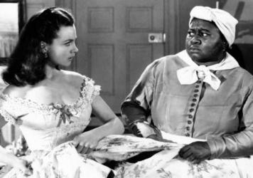 Vivien Leigh and Hattie McDaniel, as Scarlett O'Hara and Mammy in a scene from <em>Gone With the Wind</em>. The movie has been temporarily removed from the HBO Max streaming service.