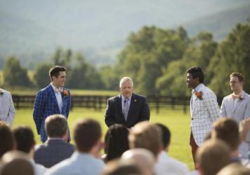 Rep. Denver Riggleman, R-Va., center, officiates the wedding of Alex Pisciarino, left, and Rek LeCounte, right, in July 2019. Some of Riggleman's Republican opponents have seized on Riggleman's decision to officiate a same-sex wedding to argue he is out