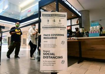 Social distancing instructions are posted at California's Westfield Santa Anita shopping mall on June 12, as local businesses enter Phase 3 reopening.