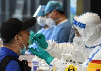 A man who visited Beijing recently gets tested Monday for the coronavirus in Nanjing in China's eastern Jiangsu province.