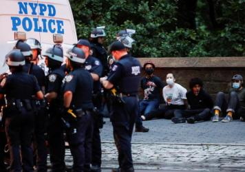 Protesters are arrested by NYPD officers for violating curfew beside the iconic Plaza Hotel on 59th Street, Wednesday, June 3, 2020, in the Manhattan borough of New York.