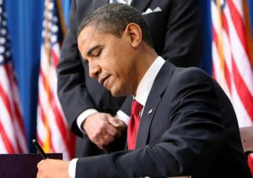 President Barack Obama signs the American Recovery and Reinvestment Act, Tuesday, Feb. 17, 2009, in Denver.