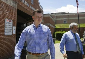 Devin Brosnan leaves the Fulton County Jail in Atlanta on Thursday after turning himself in. Authorities have charged Brosnan with four counts, including aggravated assault, in the shooting death of Rayshard Brooks.