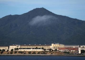 Health officials are working to keep a fast-moving coronavirus outbreak at California's San Quentin State Prison from spreading into the broader Bay Area community.