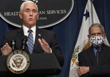 Dr. Anthony Fauci, right, director of the National Institute of Allergy and Infectious Diseases, listens as Vice President Pence speaks during a news conference Friday at the Department of Health and Human Services. The U.S. has lost more people to COVID
