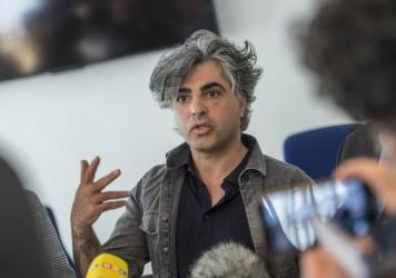 Syrian Oscar-nominated filmmaker Feras Fayyad answers journalists' questions outside a courtroom during a break in a trial against two Syrian defendants accused of state-sponsored torture in Syria, on April 23, in Koblenz, Germany.