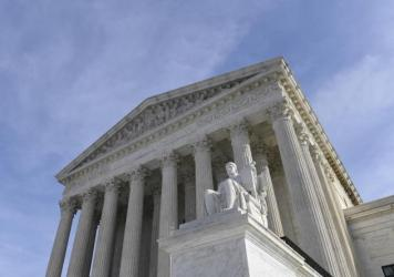 The Supreme Court decides Electoral College voters are required to support presidential candidate who wins state.