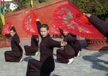 Nuns practice kung fu as a part of their daily routine at Druk Amitabha Mountain nunnery in Kathmandu, Nepal.