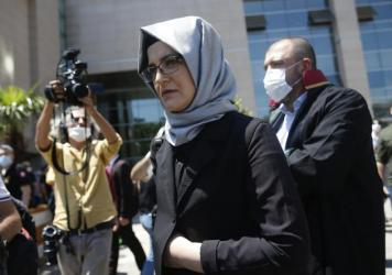 Hatice Cengiz, who was engaged to slain Saudi journalist Jamal Kashoggi, leaves a court in Istanbul on Friday. Two former aides to Saudi Crown Prince Mohammed bin Salman and 18 other Saudi nationals are on trial in absentia over the 2018 killing of the <