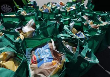 Bags of fresh food wait to be given away in Chicago in May. The number of malnourished people is expected to climb globally, according to the United Nations.