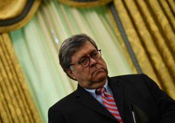 U.S. Attorney General William Barr, pictured in the Oval Office, pushed an unproven narrative about election fraud during an NPR interview.