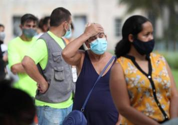 Carmen Garcia waits in line Friday to be tested for the coronavirus at a mobile testing truck in Miami Beach, Fla. The units were brought to the area as coronavirus cases spike in Florida.