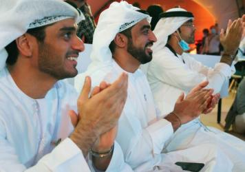 "Emirati men clap as they watch the launch of the ""Amal"" or ""Hope"" space probe at the Mohammed bin Rashid Space Center in Dubai, United Arab Emirates, on Monday. The probe, the country's first interplanetary spacecraft, was launched from Japan."