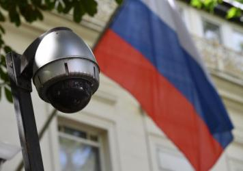 A security camera and flag adorn the entrance to the Russian Embassy in London. On Tuesday, lawmakers slammed the British government for failing to look into possible Russian interference in U.K. politics.