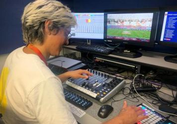 Adam Peri, sound supervisor with the broadcaster Sky UK, mixes recorded fan sounds into a Premier League soccer match.