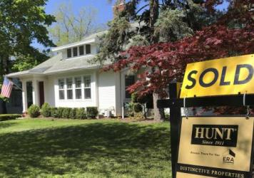 A historic drop in mortgage rates has millions of homeowners refinancing to save money. It's helping home sales, but it's not helping the broader economy as much as it would in a normal recession.
