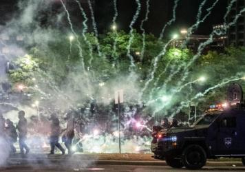 "After covering anti-police brutality protests in May, photojournalists Nicole Hester, Matthew Hatcher and Seth Herald (who took this photo) were shot with rubber pellets by Detroit Police Cpl. Daniel Debono in an ""unprovoked"" attack, according to prosecu"