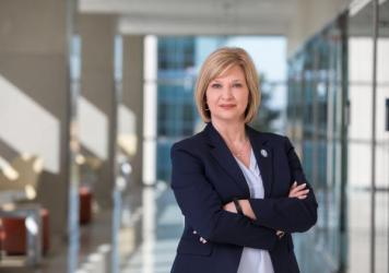 """LouAnn Woodward, who leads the University of Mississippi Medical Center, supports a statewide mask mandate. But she says state leaders are """"in a pickle,"""" based on medical advice against popular opposition."""