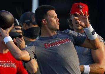 Tom Brady of the Tampa Bay Buccaneers works out during in Tampa, Fla., Tuesday. The NFL is doing daily coronavirus testing for the first two weeks of training.