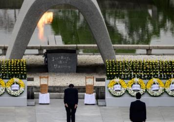 Japanese Prime Minister Shinzo Abe bows Thursday in front of a memorial to people who were killed in the 1945 atomic bombing of Hiroshima.