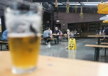Restaurants and bars in Ohio, like this one in Columbus, are under orders to stop serving alcohol at 10 p.m. nightly.